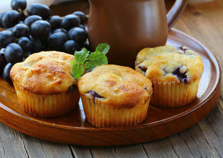 homemade fruit cupcakes on the wooden plate Stock Photo - 15042314