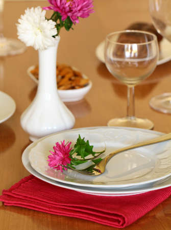 holiday table setting with flowers photo