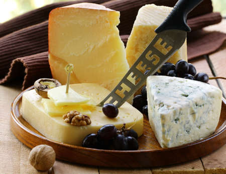 cheese platter: Still-life cheese platter with  nuts and  grapes