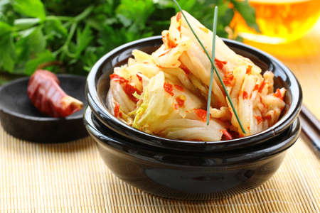 Korean cabbage kimchi with hot pepper photo