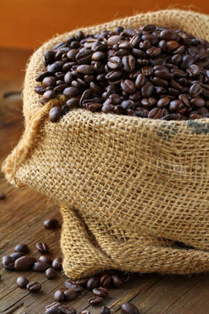 linen bag with coffee beans on wooden table photo