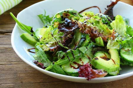 salad dressing: salad mix with avocado and cucumber,  with balsamic dressing