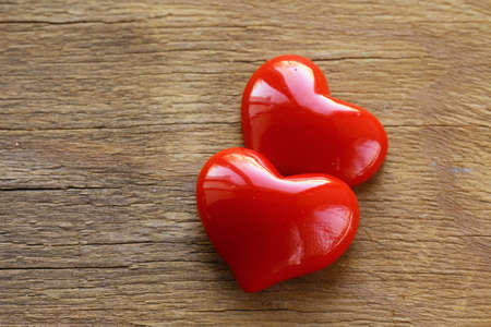 Two red hearts on wooden background Stock Photo - 15825303