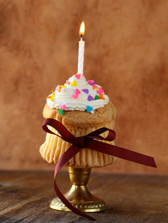first birthday: cupcake with a candle and a cream for a birthday