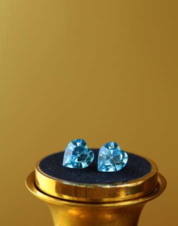 topaz: Pair of earrings topaz jewelry , macro shot on gold background  Stock Photo
