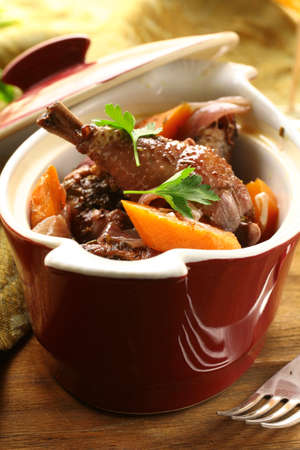 au: Traditional French cuisine - chicken in wine, coq au vin
