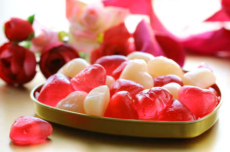 candy hearts: jelly hearts with flowers and ribbons,  sweet Valentines Day Stock Photo