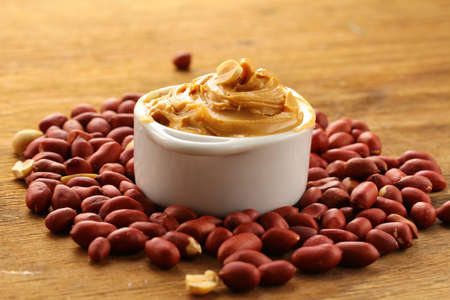 peanut butter: peanut butter and nuts on the table