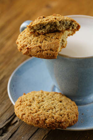 oat cookies biscuits and cup of milk photo
