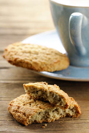 oat cookies biscuits and cup of milk