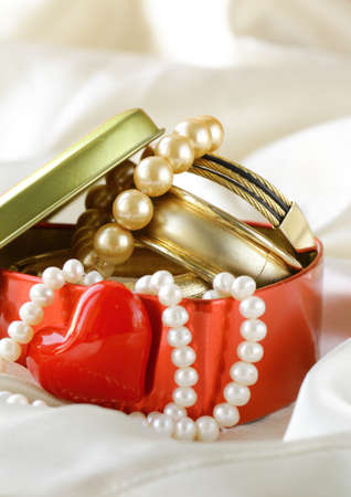 gift box with gold and pearl jewelry photo