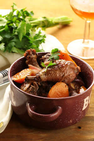 braised mushrooms: chicken in wine, coq au vin - traditional French cuisine