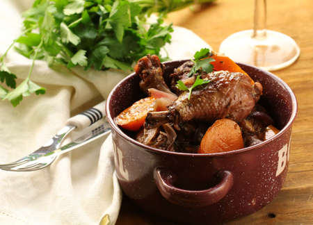 au: chicken in wine, coq au vin - traditional French cuisine