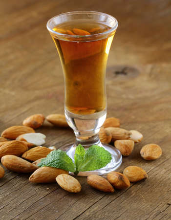 Almond liquor amaretto with whole nuts Stock Photo
