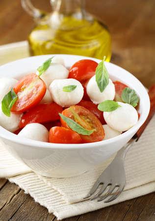 caprese salad: Italian Caprese salad with cherry tomatoes and baby mozzarella