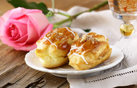 creampuff: cakes eclair profiteroles on a plate - a dessert for two