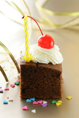 chocolate birthday cake with cherries and whipped cream photo