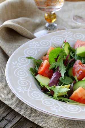 salad mix with avocado tomato and cucumber photo