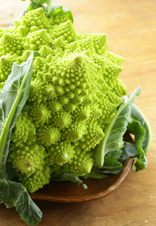 romanesco: head of cabbage romanesco on wooden plate Stock Photo