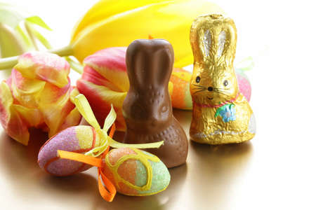 chocolate Easter bunny (sweets) with tulips photo