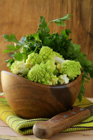 romanesco: romanesco cabbage cut in a wooden bowl