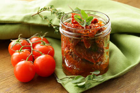sun-dried tomatoes with herbs and olive oil photo