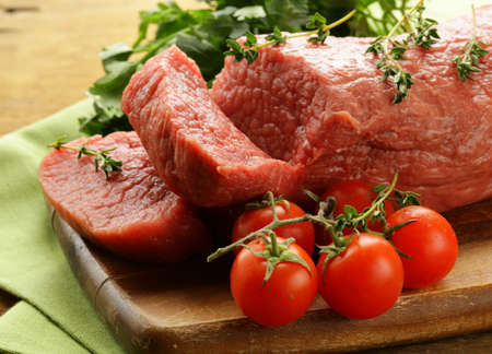 beef meat: fresh raw beef meat on cutting board Stock Photo