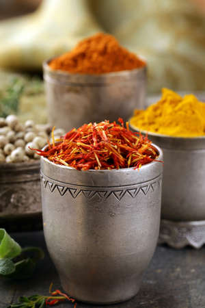 dried herb:  various spices (curcuma, paprika, saffron, coriander) in metal bowls