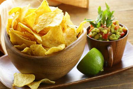 corn tortilla: corn tortilla chips in a wooden bowl