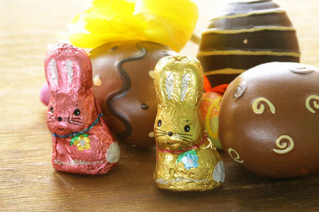 easter cookie: chocolate Easter bunny (sweets) with tulips Stock Photo