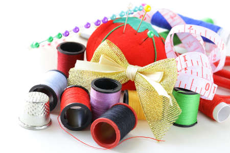 remnants: sewing utensils - coils colored threads, pins, thimble