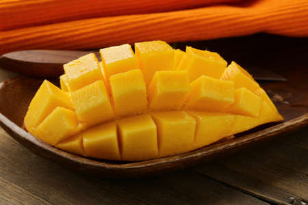 mango fruit: fresh fruit mango on wooden plate Stock Photo
