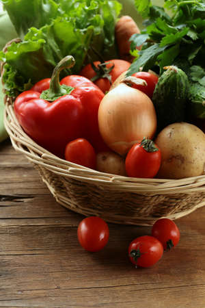 vegetable basket: fresh vegetables  and herbs mix in a wicker basket