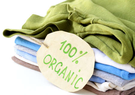 biologic: stack of multicolored clothing with organic label