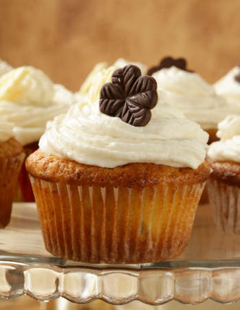 cupcakes  with cream and chocolate decorations photo