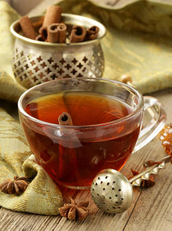 Tea with spices - cinnamon, a carnation and an anise photo