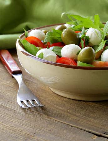 salad with arugula, tomatoes and mozzarella cheese Stock Photo - 19027117