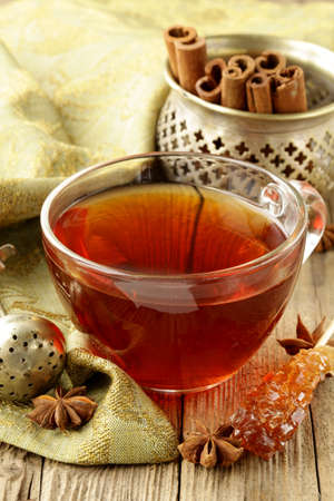 stick of cinnamon: Tea with spices - cinnamon, a carnation and an anise Stock Photo