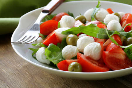 salad with olives, tomatoes and mozzarella cheese Stock Photo - 19313395