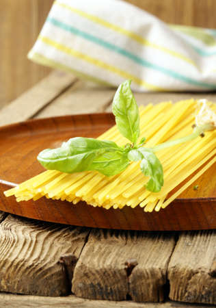 types of pasta on a wooden table photo