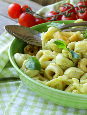 Italian tortellini with basil and olive oil photo