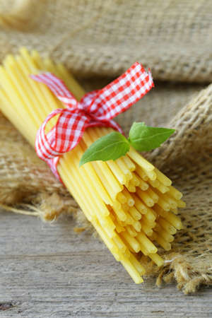 Italian still life - pasta on a wooden table photo