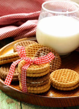 homemade cookies  sandwich  with milk on a wooden table photo