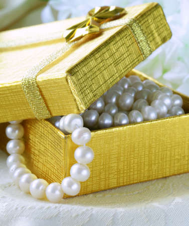 pearl necklace in a gold gift box photo
