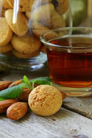 amaretto: Dessert liqueur Amaretto with almond biscuits  amarittini  and nuts