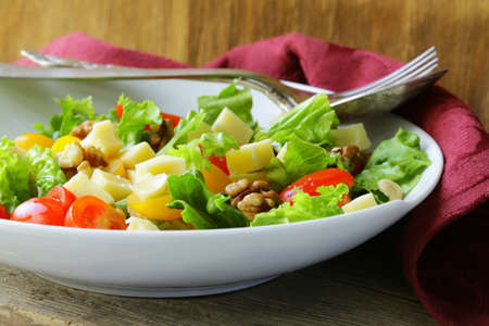 snack salad with cheese and walnuts photo