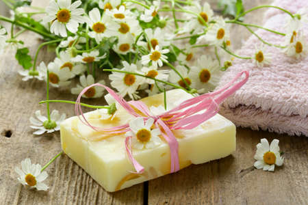 chamomile flower: handmade soap with flowers on the organic background
