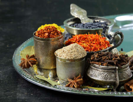 collection of various spices  paprika, turmeric, pepper, aniseed, cinnamon, saffron  photo