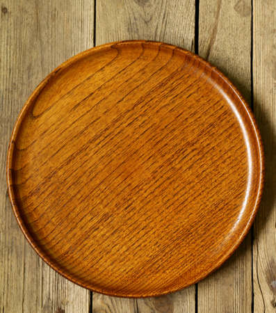 rustic kitchen: empty wooden plate on the old wooden table Stock Photo