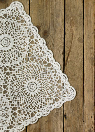 tablecloth: wooden background with white lace napkin Stock Photo